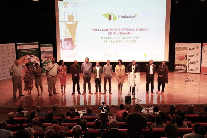 The cast and crew of Ithubalami being congratulated on stage.